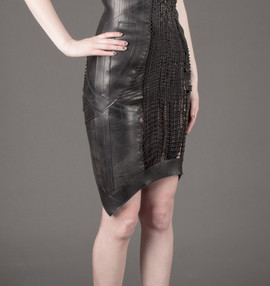 Tire dress with woven elastic