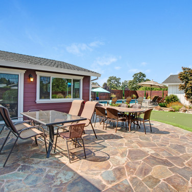 Back yard patio with ample seating, bbq, pool, spa and pool house