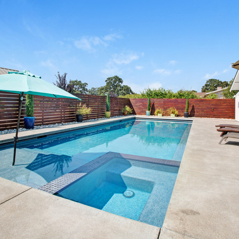 Pool and hot tub with baja deck