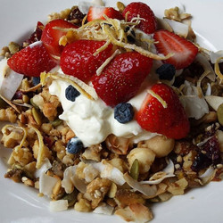 Homemade granola filled with a mix of almonds, pistschios, macadamia,  sunflower and pepita seeds to