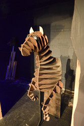 Hand sketched and individually cut out pieces from luan and plywood. The horse is hinged at the bottom to rock back and fourth to appear galloping.