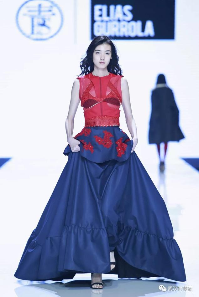Intelocked crop top, and long navy skirt