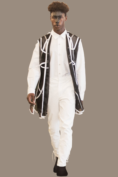 Long interlock vest, over white button up, and white trouser