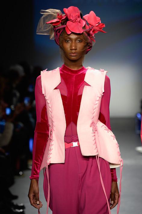 Pink coreset over magenta velour bodysuit