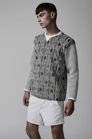 Geo sweater over white seersucker shorts