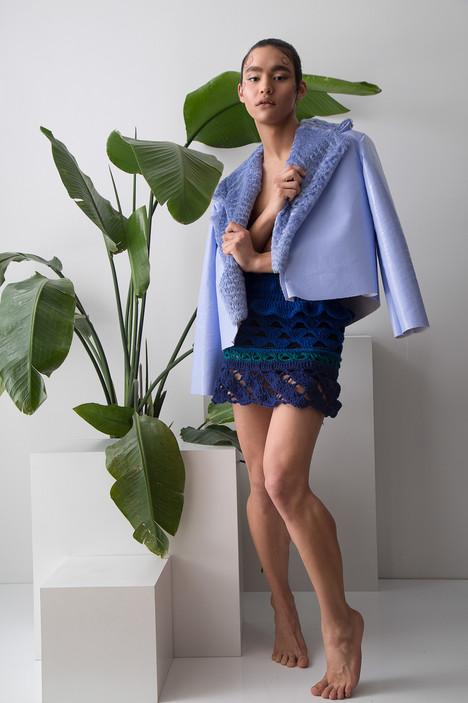Vinyl jacket and hand knit skirt
