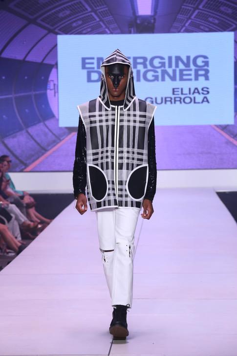 Heavy plaid vinyl raincoat, over open knee lace up trouser
