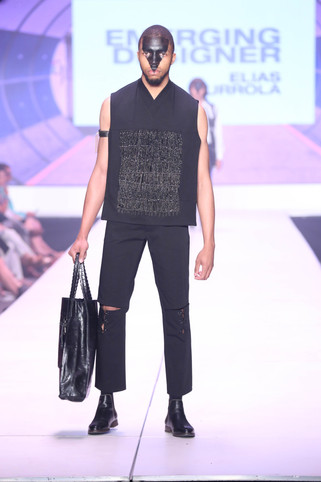 Black beaded bib, open knee lace up trouser, and black leather tote