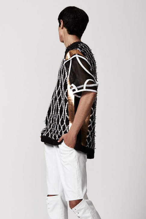 Machine knit, black, white, and gold sweater over white open knee trouser