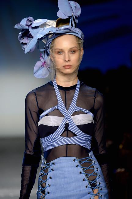 Strap bra top over navy velour bodysuit