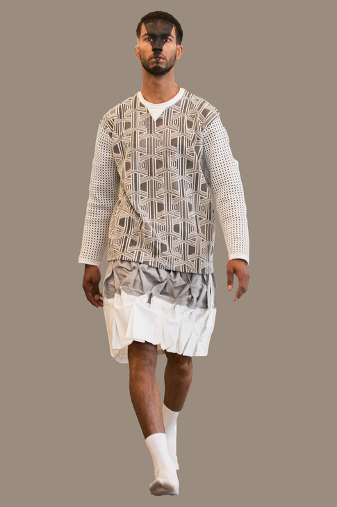 Geo sweater over pleated skirt