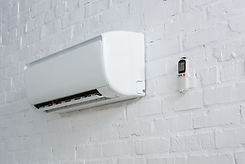 air-conditioner-hanging-on-white-brick-w