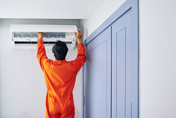 worker-installing-air-conditioner-54TA49
