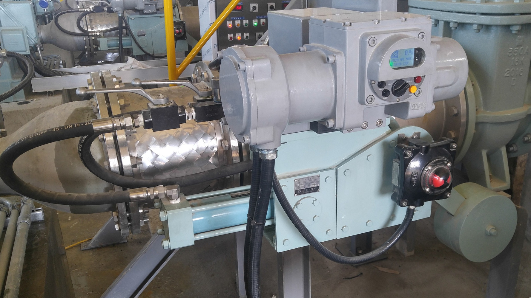 Close-up view of Pump Control Valve (PCV) System installed on Water Pump