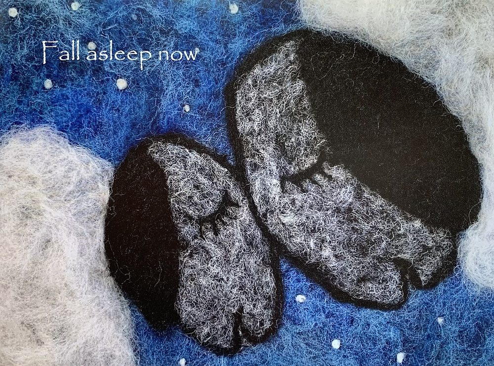 Needle felted scene mama and baby sheep with their faces touching