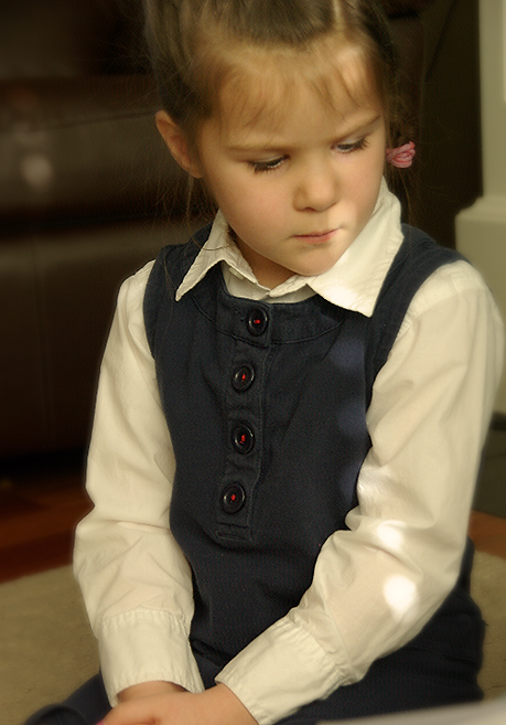 A Kindergarten student listening