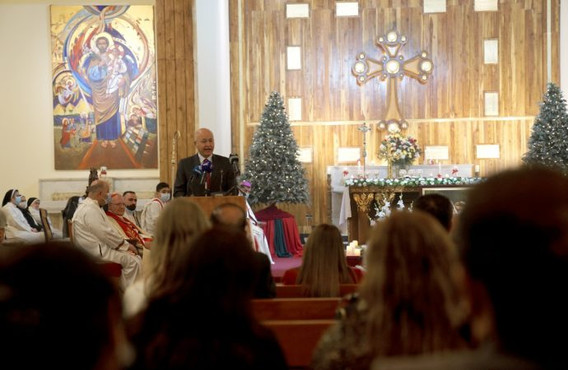 At Christmas Mass, Iraq's Muslim president calls for Christians to be protected