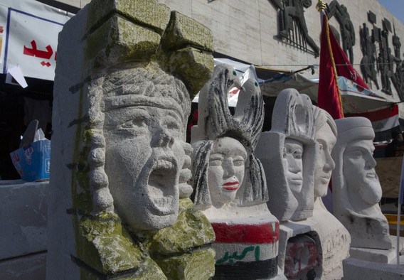 Iraqi artists pay tribute to dead protesters with sculptures