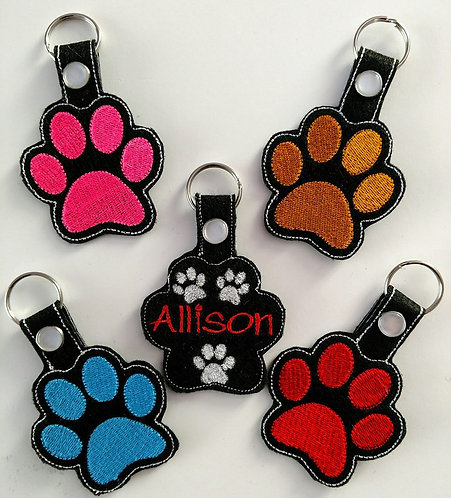 Paw print key chains or zipper charms!