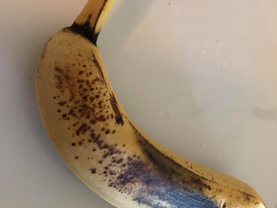 Untitled  a single banana on a lonely plate spotting browning that single banana left for me his tum