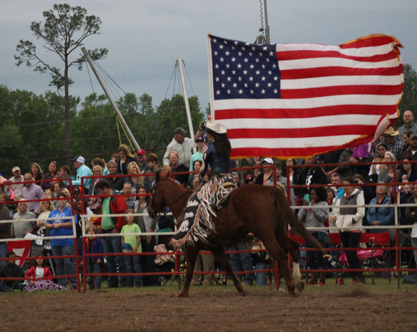 Miss Rodeo presents the colors