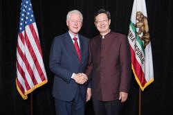 Robert Sun with President Clinton