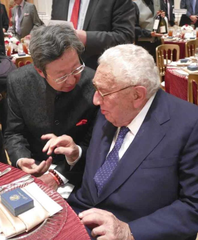 Robert Sun with Henry Kissinger