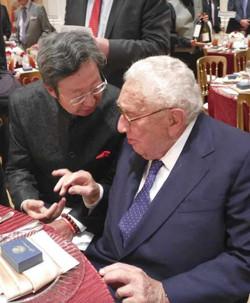 Robert Sun with Henry Kissinger