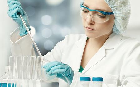 Young female tech or scientist loads liq