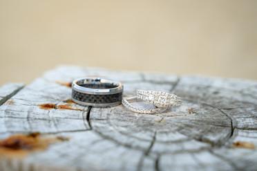 Wedding rings on weathered wood
