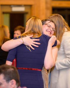 Bride embracing a friend
