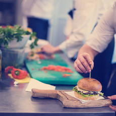 chef-finishing-burger-P6SLH9P.JPG