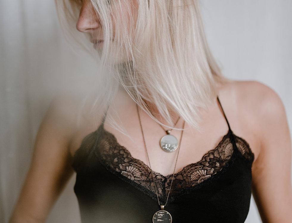 black & gold pendant