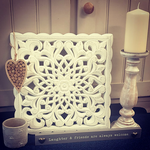 Ornate floral wall hanging