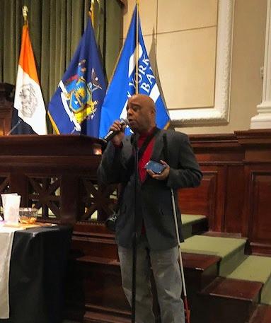 Frank Senior singing at a ceremony.