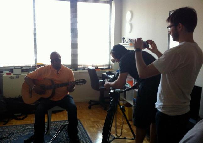 Frank with guitar being filmed