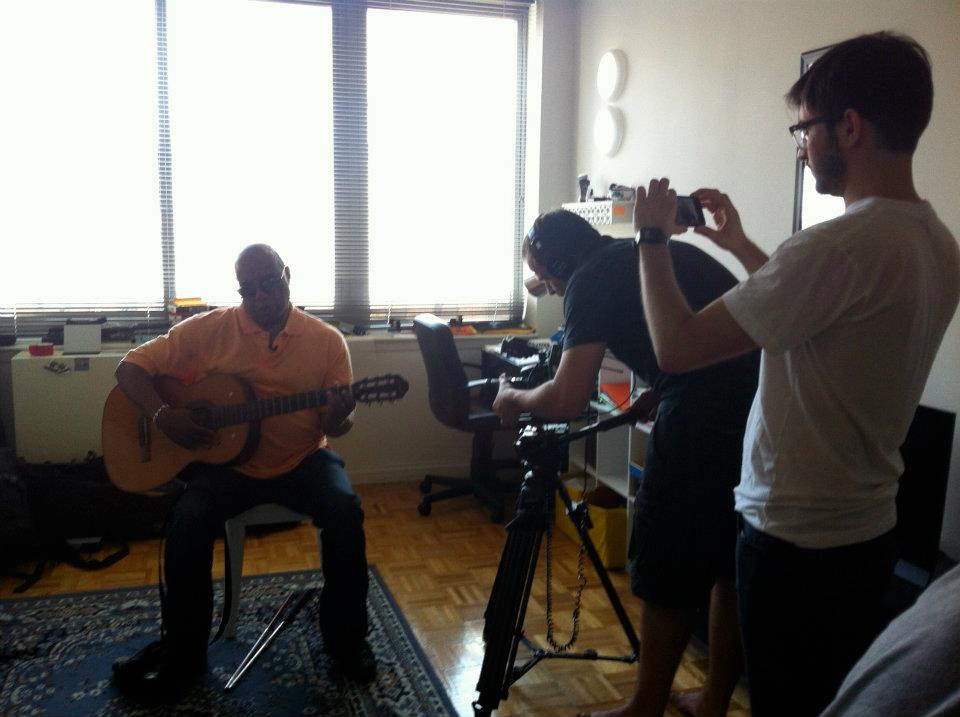 Frank with guitar being filmed