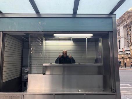 Frank standing in his beautiful, yet empty, rebuilt newsstand_