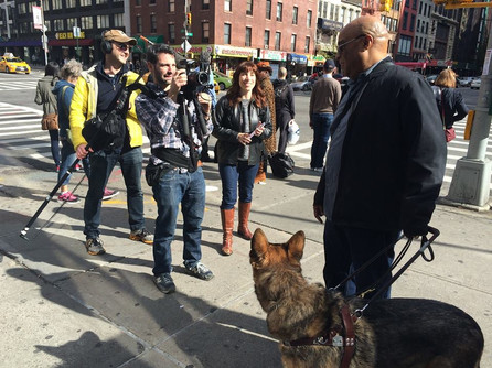Frank with his guide dog being filmed in NYC