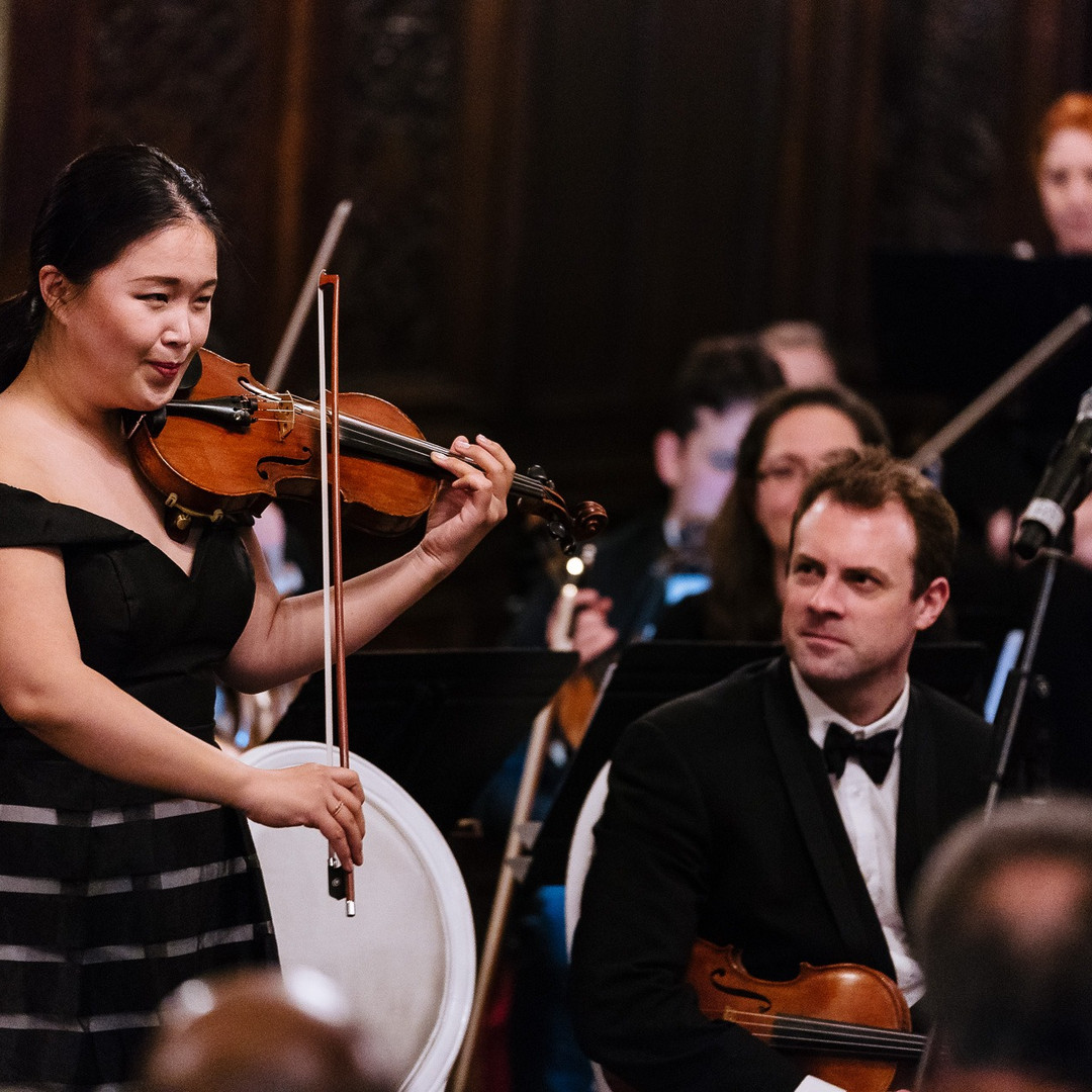 1st Violin, Sharon Lee with Soprano Pandora Topp, Violinist, Marcus Scholtes looking on