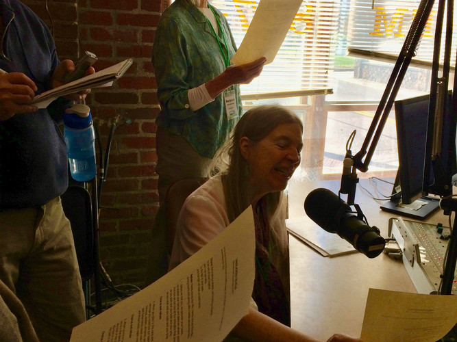 """Sarah Pirtle leads the group in singing """"Hands Across the Hills"""" on Appalshop radio"""
