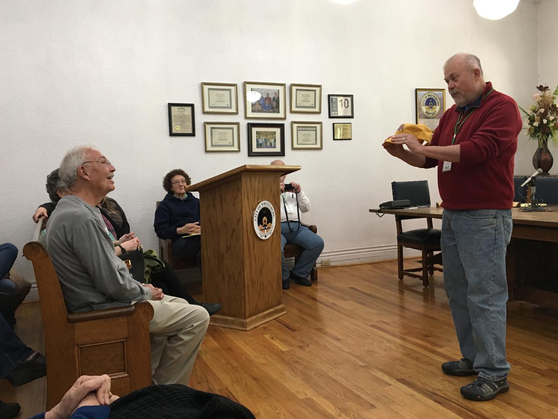 Jay presents a Rattlesnake Gutter Trust hat to Whitesburg Mayor James W. Craft