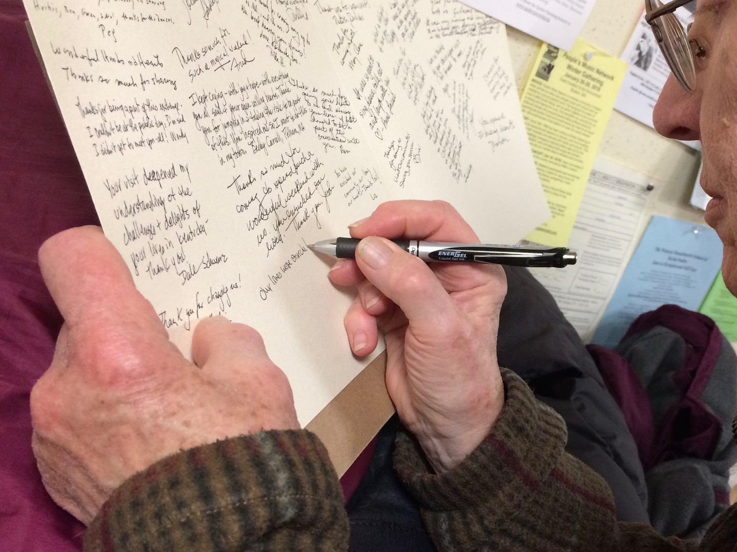 Signing the thank-you card