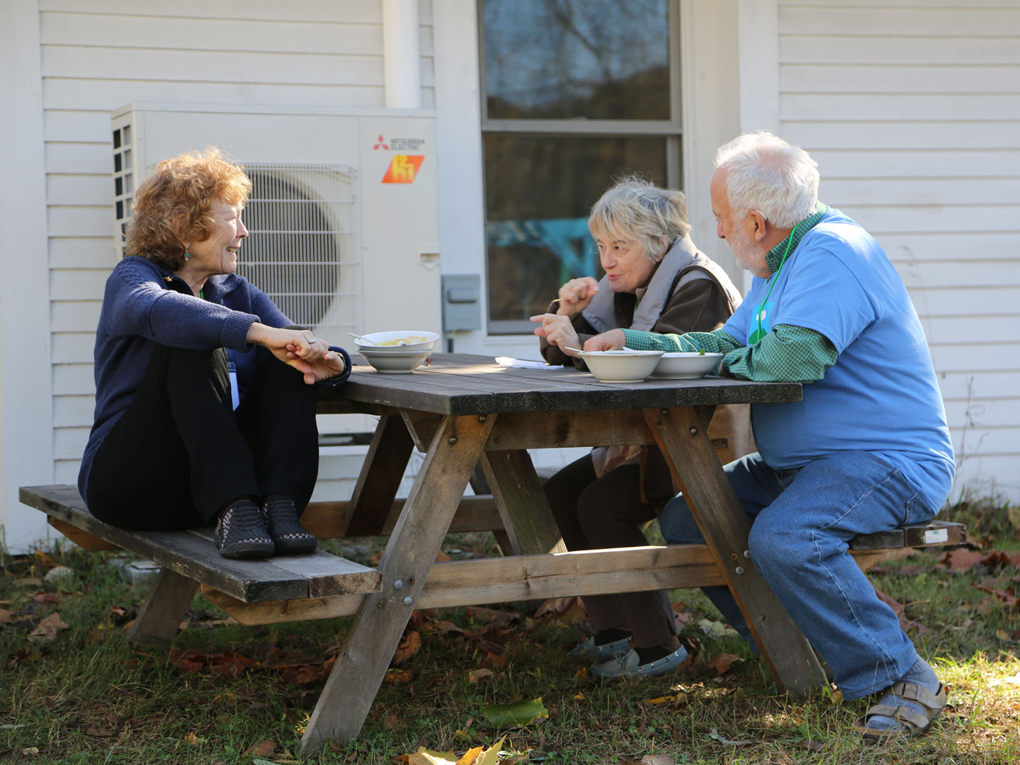 Sharon, Susan and Tom take a break during dialogue session