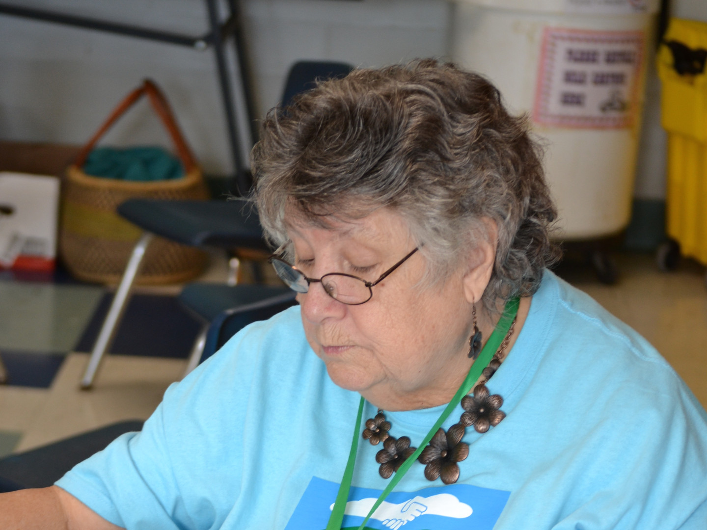 Letha from Letcher Co. looking over books she was gifted from the Leverett Library