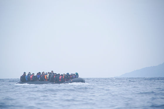 Refugees_on_a_boat_crossing_the_Mediterr