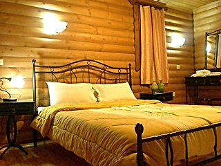 Chalet Likouresi Village Luxury Cabins Bedroon in Karpenisi Greece