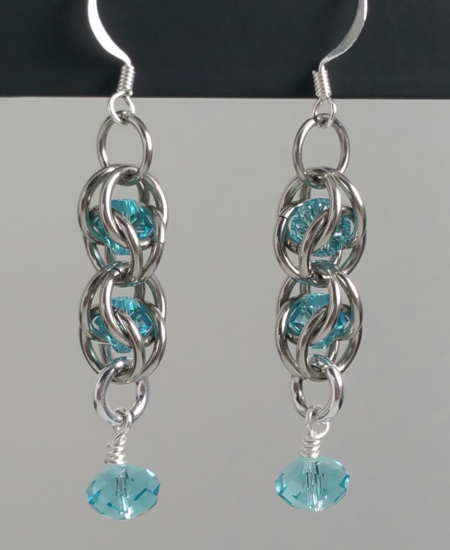 1-Swarovski  captured earrings 2 inches.