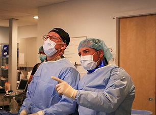 Drs. Davis and Esposito scrubbed in for