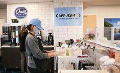 Employees making protein shakes.jpg